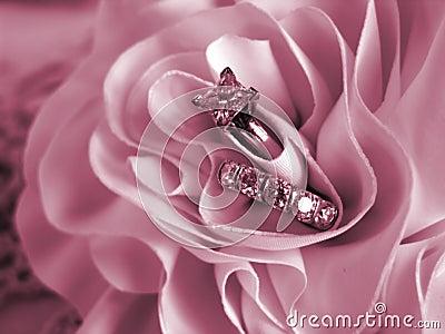 wedding rings in a pink rose royalty free stock photos image 12285628 - Pink Wedding Rings