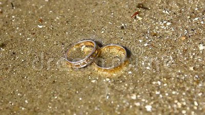 Wedding rings sea. Wedding rings on the seashore