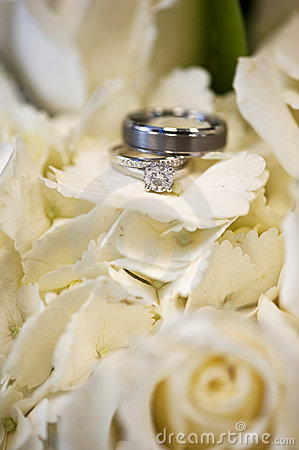 Wedding rings in white flowers