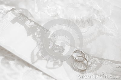 Wedding rings and white laces
