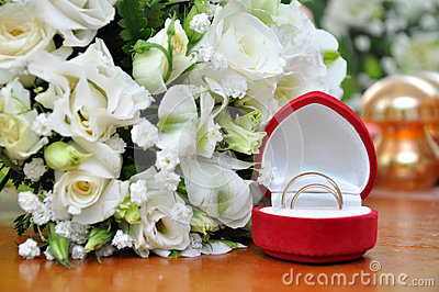 Wedding Rings and White Rose Bouquet