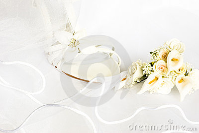 Wedding sandals and flowers over veil