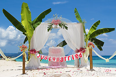 Wedding setup and flowers on tropical beach background