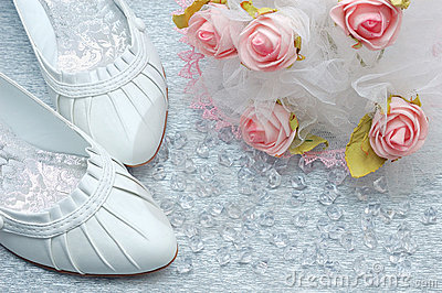 Wedding shoes with bridal bouquet and crystals