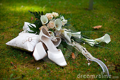 Wedding shoes rings and bouquet