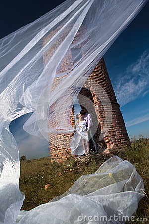 Wedding shot against abandoned ruins