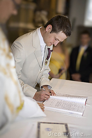 The wedding signature. Groom signing the register
