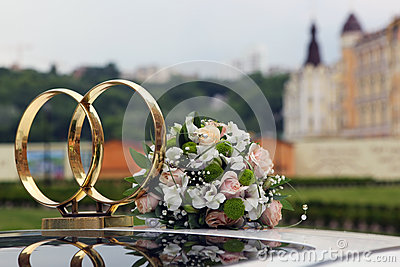 Wedding symbol - two crossed rings on the roof of the car and th