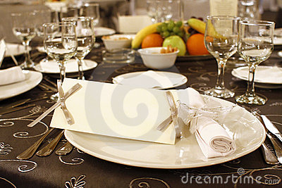 Wedding table arrangement with blank invitation