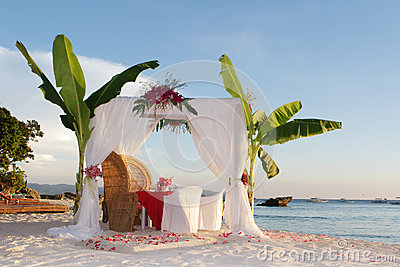 Wedding table and set up with flowers on beach