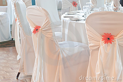Wedding table with white linen and covered chairs