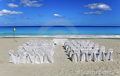 Wedding on tropical beach.   Chairs and tables in
