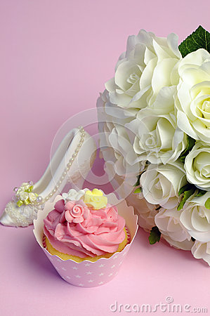 Wedding white roses bouquet with pink cupcake - vertical.