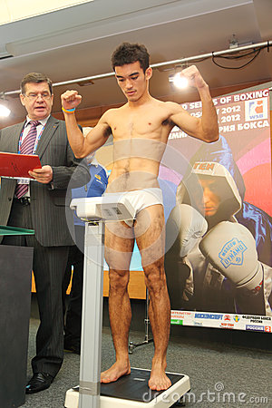 Free Weighing Underwear Boxer On Press Conference Royalty Free Stock Images - 28023309