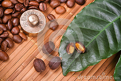 Weight with coffee beans and leaf