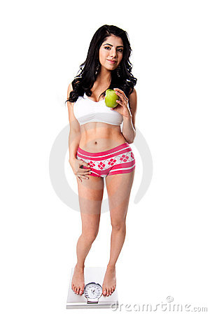 Weight concious woman with apple