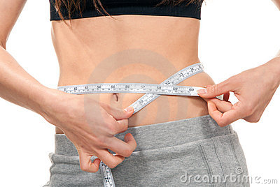 Weight loss concept measuring her waist