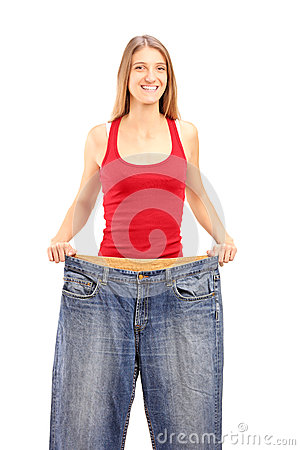 A weight loss female showing her old jeans
