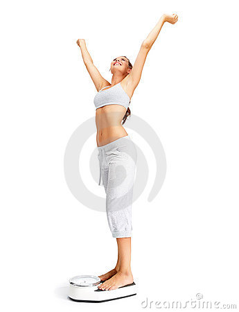 Weight loss - Fit young girl on a weighing scale