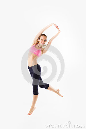 Weight loss fitness woman jumping of joy. Caucasian female model