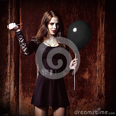 Free Weird Angry Girl Is Piercing A Black Balloon By Needle Royalty Free Stock Photos - 47441608