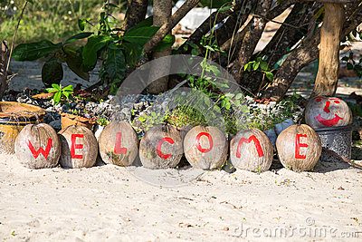 Welcome painted on coconuts