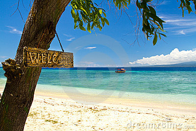 Welcome sign to paradise beach and sea on island