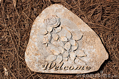Welcome Stepping Stone on Pine Straw
