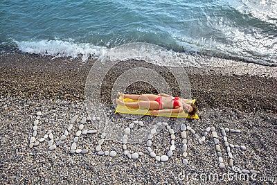WELCOME at stony coast, woman on mattress