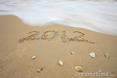 Welcome to new year 2012 write on sand beach