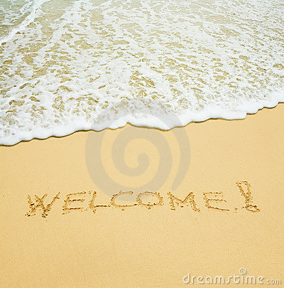 Welcome written in a sand