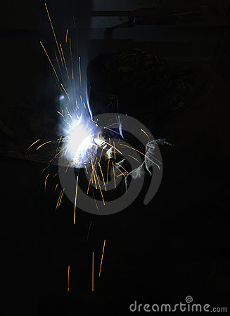 Welder fabricating steel