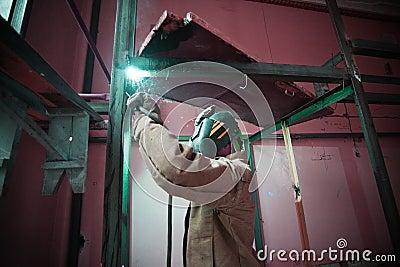 Welder welding in a factory