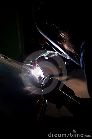 Welder working in factory