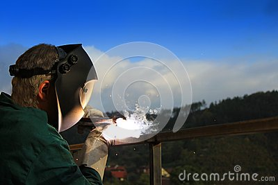 Welder working outside
