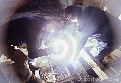 Welders at work on ship