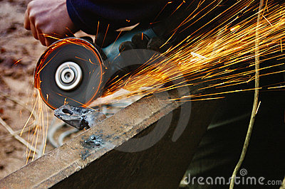 Welding metal, sparks spreading
