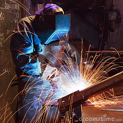 Welding worker in factory