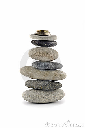 Welfare and Stability  - stone stack with coins