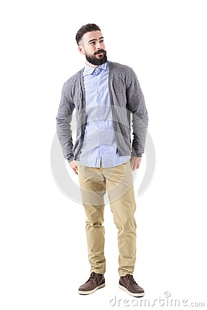 Free Well Dressed Man Fashion Model In Gray Cardigan Looking Up With Hands In Back Pockets. Royalty Free Stock Photography - 108116507