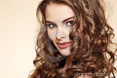 Wellness. Beautiful model with long curly hair