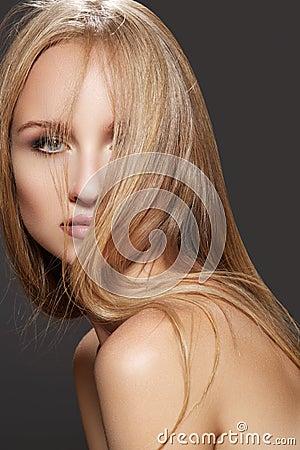 Wellness, hairstyle. Beautiful straight shiny hair