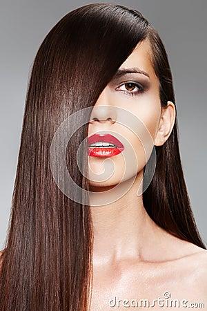 Wellness. Сosmetics. Woman with shiny long hair