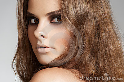 Wellness. Woman with long hair and evening make-up