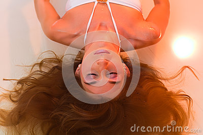Wellness - young woman floating in Spa