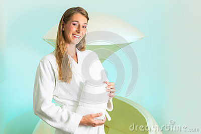 Wellness - young woman floating in Spa in Tank
