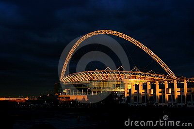 Wembley Stadium in the sunset.
