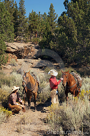 Western couple trail riding