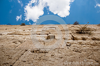 Western wall with ancient stones on blue sky background jerusalem