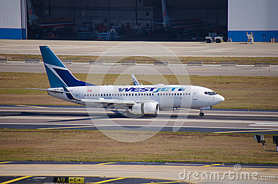 WestJet Boeing 737 landing at Tampa Int l Airport Editorial Image